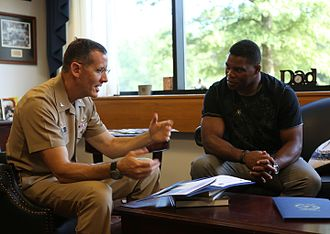 Herschel Walker - Herschel Walker talks with Navy Capt. David Lane.