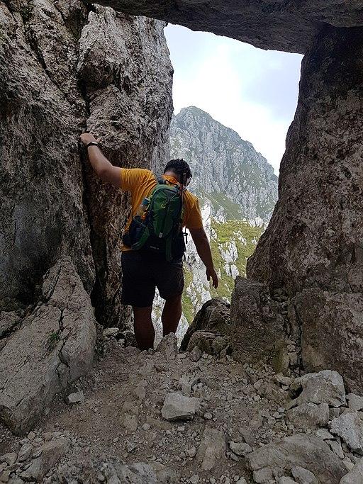 Hiker on path 501 from Monte Alben to Monte della Croce - Bergamo, Lombardy, Italy - 2020-09-13