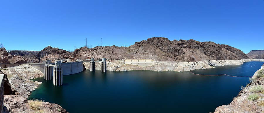Hoover Dam panoramic view from the Arizona side showing the penstock towers, the Nevada-side spillway entrance and the Mike O'Callaghan – Pat Tillman Memorial Bridge, also known as the Hoover Dam Bypass