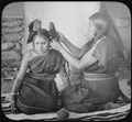 Hopi woman dressing hair of unmarried girl, 1900 - NARA - 520082.tif