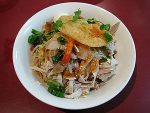 Vietnamese dry rice noodles (hu tieu kho) with...