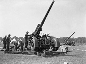 34th (South Midland) Anti-Aircraft Brigade - Mobile 3.7-inch HAA guns in action, early in World War II.