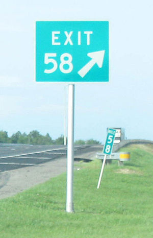 Exit number - On a road with distance-based exit numbering, the exit number (shown here on a gore sign) matches a nearby mile or kilometer marker.