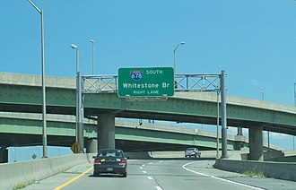 Bruckner Interchange - Signage for I-678 on the ramp from I-278 eastbound. Two of the interchange's many ramps are visible in the background.
