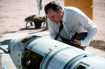 A Soviet inspector examines a BGM-109G Gryphon ground-launched cruise missile in 1988 prior to its destruction. INF inspection.JPEG