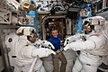 ISS-59 Christina Koch and Nick Hague with David Saint-Jacques inside the Quest airlock.jpg