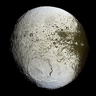 Iapetus (moon) - Cassini mosaic of Iapetus, showing the bright trailing hemisphere with part of the dark area appearing on the right (the equatorial ridge is in profile on the right limb). The large crater Engelier is near the bottom; to its lower right can be seen the rim of a partly obliterated, slightly smaller older crater, Gerin.