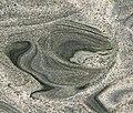 Iguana Green Granite (gneiss) (quarry near Messias Targino, Rio Grande do Norte, Brazil) 4 (33877396621).jpg