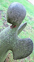 Insects (Pyrrhocoris apterus) forming a red collar to a statue.jpg