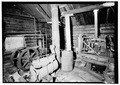 Interior of machine shop with diesel compressor - Stampede Gold Mine, Kantishna, Denali Borough, AK HAER AK-31-25.tif