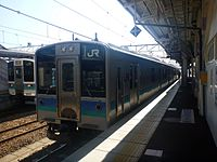 JRE E127 at Shinano-Omachi Station (10440552504).jpg