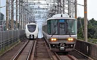 Kosei Line - Special Rapid Service train (right) and Thunderbird limited express (left) at Hira Station