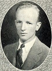 a black-and-white picture of a 21-year-old man wearing a white shirt, tie and sport coat, from his college yearbook