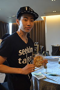 Jay Park holding a cookie from Jay Park Network.jpeg