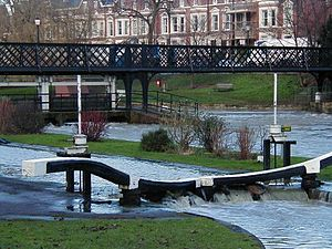 Jesus Lock - The lock and footbridge during flooding in 2001.