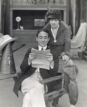 John Emerson (filmmaker) - John Emerson and Anita Loos look over a script on a film set in 1918.