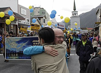 Jonathan Kreiss-Tomkins - Kreiss-Tomkins greeting a spectator at the Alaska Day Parade in downtown Sitka (2014)