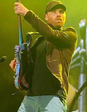 Jonny Buckland - Buckland, performing with Coldplay in 2011