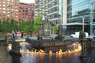 Public art - La Joute by Jean-Paul Riopelle, an outdoor kinetic sculpture installation with fire jets, fog machines, and a fountain in Montreal.