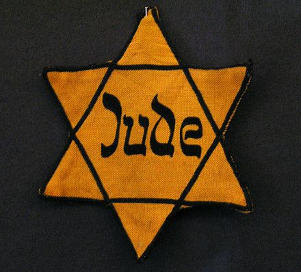 The yellow Star of David badge, already compulsory in Nazi Germany, was enforced elsewhere in occupied Europe in September 1941 Judenstern JMW.jpg