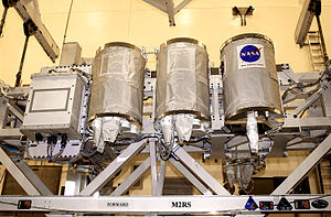 Hitchhiker Program - The Hitchhiker Bridge Carrier System with GAS canisters being prepared for STS-107.