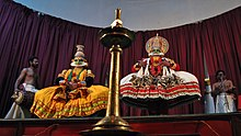 Kathakali performance in front Of big oil Lamp.