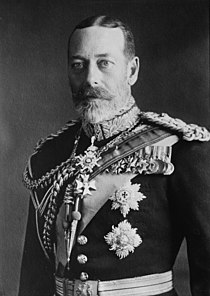 George V is pale-eyed, grey-bearded, of slim build and wearing a uniform and medals