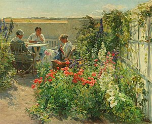 Knud Larsen - Knud Larsen: Flowery Garden Exterior with Three Women at a Table (1916)