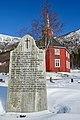Lønset kirke-kyrkje (wooden church built 1863) in Oppdal, Trøndelag, Norway. Minnestein over Kletthamranskredet, snørasulykke 1868-02-12 (Memorial of avalanche 1868). 2019-03-19 . Snow, blue sky H.jpg