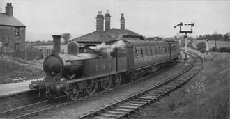 """Anglesey Central Railway - LMS continued to operate LNWR-built engines on the line. Pictured is an ex-LNWR 2-4-2T (5'6"""") leaving Holland Arms in April 1945"""