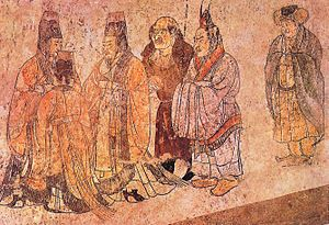 """Prince Zhanghuai - From Paludan's source: """"In this mural foreign ambassadors are being received at court. The two elegantly clad figures on the right are from Korea, the bare-headed, large-nosed figure in the center is an envoy from the west. Mural from Li Xian's tomb, Qianling Mausoleum, Shaanxi, 706."""""""