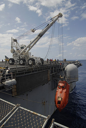 Maersk Alabama hijacking - The lifeboat from the Maersk Alabama is hoisted aboard the amphibious assault ship USS Boxer to be processed for evidence.