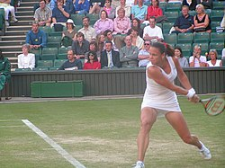 Davenport preparing to return a ball at the 2004 Wimbledon tournament.