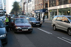 Breakdown (vehicle) - An overheated Vauxhall Carlton stopped on Tottenham Court Road, London