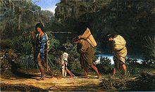 Louisiana-indianen die langs een Bayou.jpg lopen