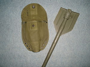 Entrenching tool - U.S. military M43 E-Tool first used during WWII. Note: folding blade can be used as both a shovel or pick