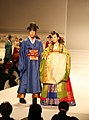 Male and female wedding hanbok at a fashion show.jpg
