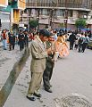 Man who goes a piece of fireworks during celebrations in La Paz in Bolivia contrasted.jpg