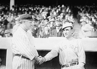 John McGraw - John McGraw greets fellow manager Jake Stahl at the 1912 World Series.