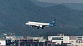 Mandarin Airlines Embraer 190 B-16822 on Final Approach at Taipei Songshan Airport 20150104a.jpg