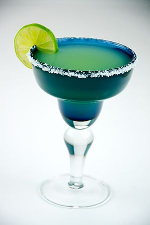 English: Margarita with lime in a margarita glass.