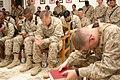 Marines pray in camp chapel during memorial service for Corporal Ramona Valdez, 2005.jpg