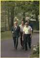 Menahem Begin and Israeli delegates stroll around Camp David during peace summit. - NARA - 181155.tif