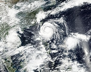2016 Pacific typhoon season - Three storms active during September 13: Rai (left), Meranti (center) and Malakas (right)