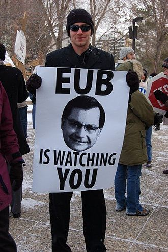 Ed Stelmach - Activist Mike Hudema holding a depiction of Stelmach while protesting Bill 46.
