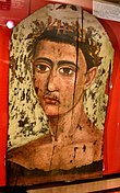 Mummy portrait of young man from Fayum, Hawara. First to second century AD. Petrie Museum.jpg