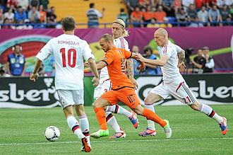 Simon Kjær - Kjær attempt to block Wesley Sneijder shot in the UEFA Euro 2012 campaign.