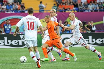 Kjaer attempt to block Wesley Sneijder shot in the UEFA Euro 2012 campaign. NED-DEN Euro 2012 (07).jpg