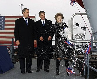 USS Ronald Reagan - Former First Lady Nancy Reagan christens Ronald Reagan with President George W. Bush and former Newport News Shipbuilding CEO William Frick looking on, 4 March 2001.