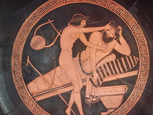Slavery in antiquity - A drunk man vomiting, while a young slave is holding his forehead. Brygos Painter, 500-470 BC